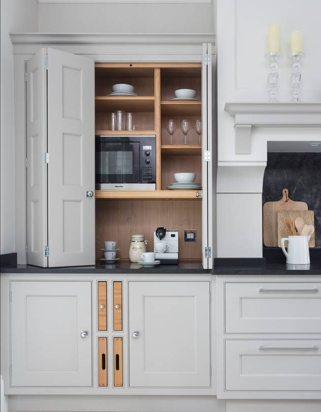 Designers use cabinetry and accessories to make home bars work for everything from breakfast smoothies to midnight buffets.
