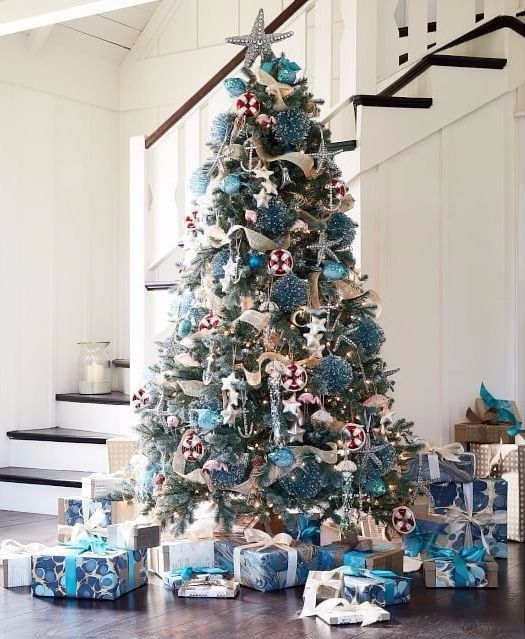 Coastal Christmas Tree with Blue Sparkle Ornaments, Jeweled starfish ornaments and a fab starfish topper by Pottery Barn. Featured on Completely Coastal: http://www.completely-coastal.com/2017/11/coastal-christmas-ornaments-blue-jewels.html