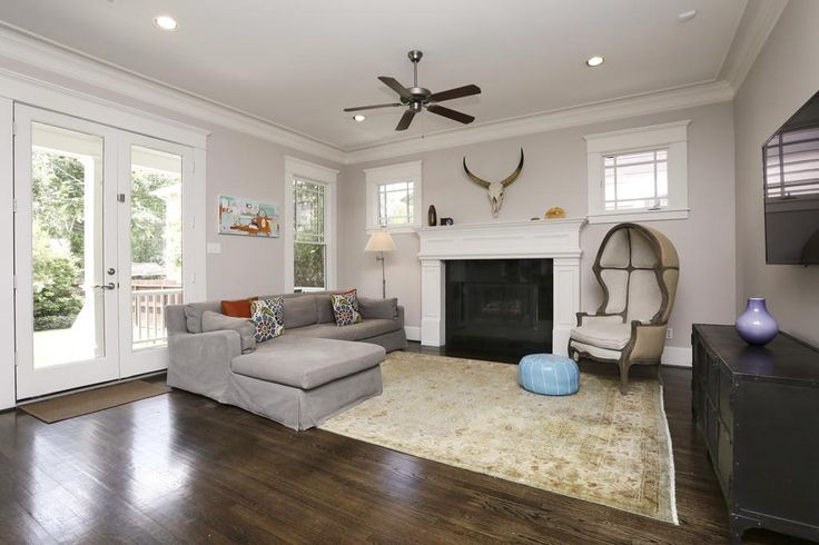 Informal Living Room That Features French Doors Lead To The Large Back Porch Yard A Gas Fireplace W Granite Surround And Mantle Beautif
