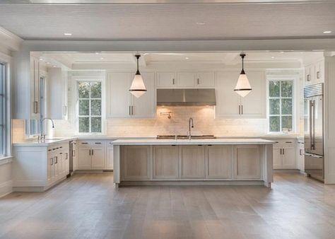 Kitchen with white oak flooring and white oak island.