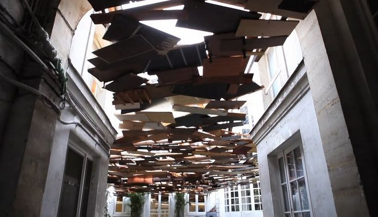 """""""Artist and sculptor Tadashi Kawamata has a brand new installation at kamel mennour gallery in Paris. Chaotic slabs of wood hang above the courtyard creating a  somewhat unsettling ceiling that blots out the sky...swelling and swaying...visitors may recall footage of debris floating on the surface of the ocean after being swept away by the 3/11 tsunami, only to realize that their world has now been flipped upside down; they are staring up at the debris from under the water."""""""