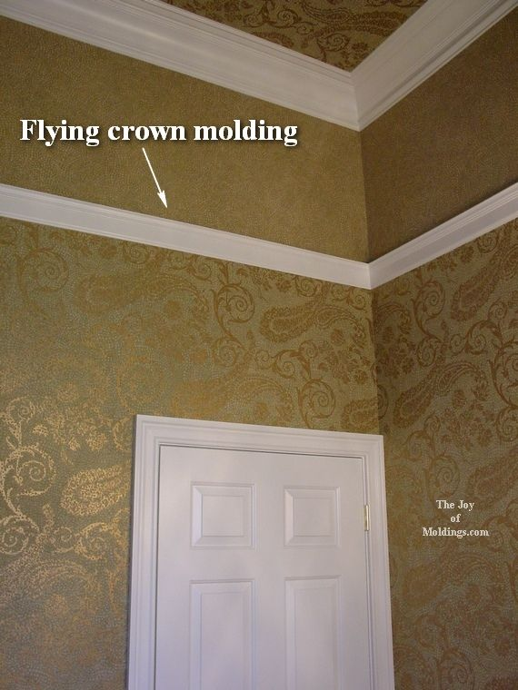Flying crown molding is perfect to break up the 12 ft ceilings. Add an  accent color .