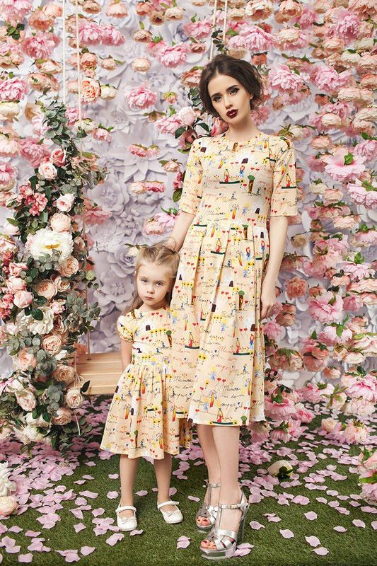 Tea-length matching dresses for mother and daughter with cute print. Perfect for childrens birthdays or any other special occasion.  Price is shown