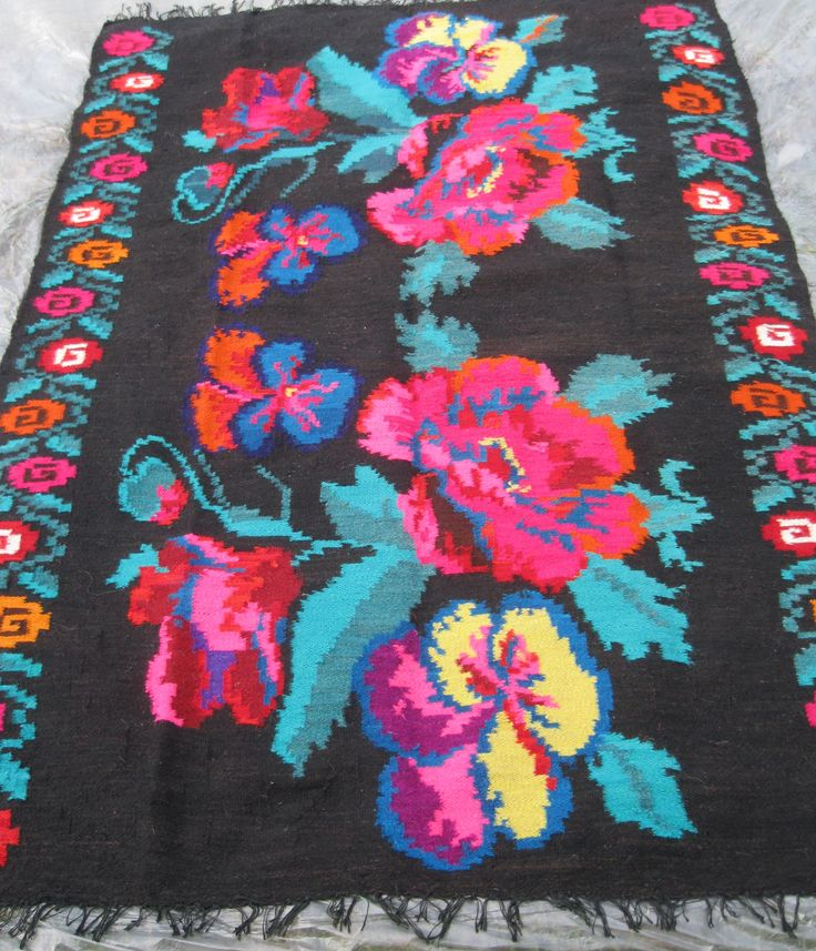 Beautiful antique traditional Romanian woven wool carpet / rug with floral pattern. Hand woven in Northern Transylvania / Maramures county 50 - 70 years ago. Hand woven with wool on cotton thread foundation.  At www.greatblouses.com