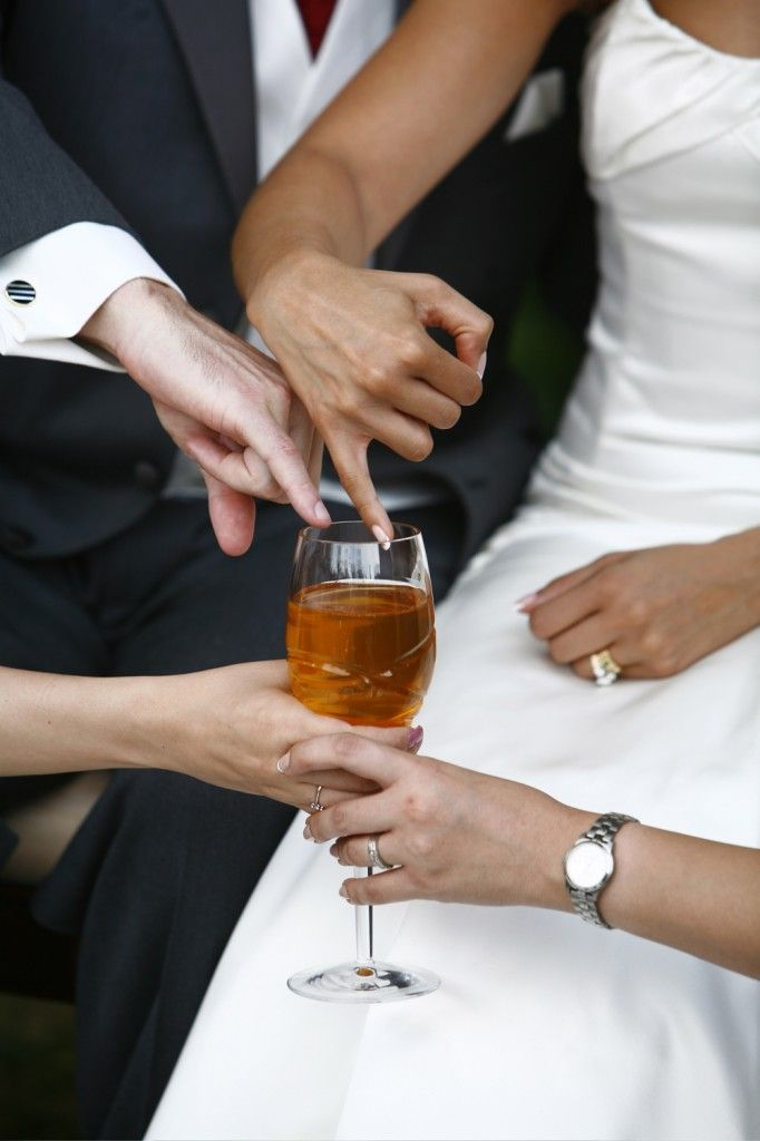 the tradition is after the couple is married, they dip their pinkies into the honey that's on the sofreh aghd and then feed it to each other. sticky but adorable! i'm willing to take the chance. :)