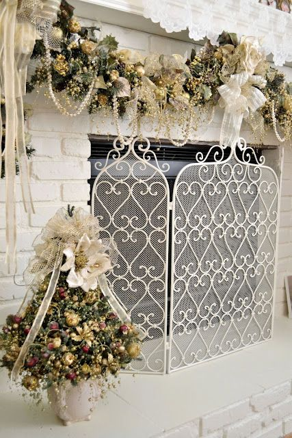 a glistening white christmas - loving the fireplace screen