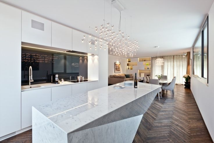 Interior, Kitchen Interior Design With Crystal Pendant Lamp Long Sparkling White Granite Kitchen Island Table White Accent Wall Modern White Laminate Kitchen Cabinet With Pull Down Kitchen Faucet And Black Cooktop Black Backsplash: Perfect and Ideal Kitchen Interior Design Ideas