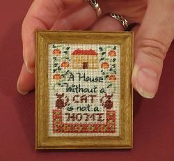 Picture showing the finished sampler mounted in its frameCat Cross Stitch Samplers, Cat Picture Frame, Finish Sampler, Crafts Embroidery, Minis, Crosses Stitches, Dollhouse Needlework, Dolls House, Dollhouse Miniatures