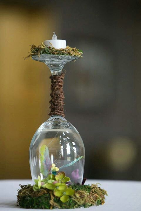 drinking glass put upside, made into a candlepiece centerpieces with suspending butterflies