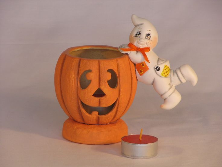 here is a cute hand painted pumpkin candle holder with a ghost hanging on the side homemade halloween decorationspumpkin