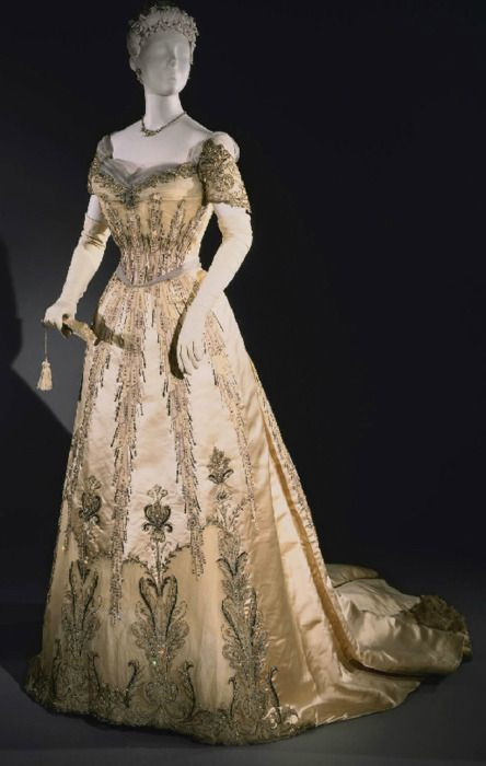 Woman's Evening Dress: Bodice and Skirt Made in New York, United States, North and Central America ca.1907. Designed by Mrs. Dunstan, American, active 1891 - 1913. Ivory silk satin with silk tulle, lace, tulle appliqué, rhinestones, and sequins; floss silk, silk chenille, and metallic thread embroidery. Gift of Mrs. Priscilla de Mauduit, 1967. Philadelphia Museum of Art.