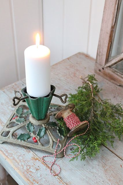 antique Christmas Tree stand turned into candle holder. Swoon.