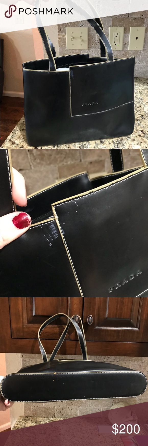 Authentic black Prada bag The cutest little bag for every day essentials 100% authentic. It's definitely been loved and has a few spots that aren't extremely noticeable. There is a hole in the material of the bottom of the bag but could be fixed for like 30 bucks. Price reflects love. Has soooo much life! Prada Bags