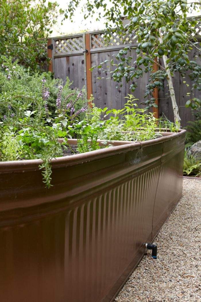 Steal This Look: Water Troughs as Raised Garden Beds Gardenista - what else could I find & convert to a garden?