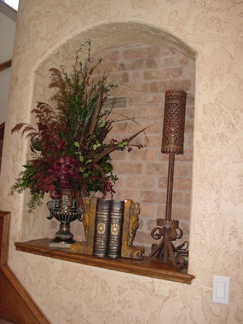 At art niche with a brick wall adjacent to a stair system in a home we built in Trophy Club
