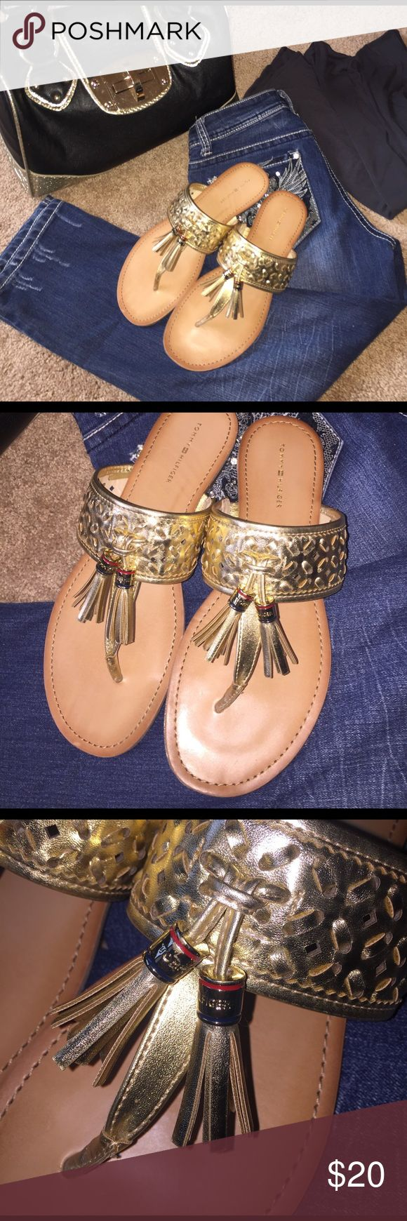 NWOT Tommy Hilfiger gold sandals sz 9 🖤🖤🖤 Tommy Hilfiger NWOT size 9, gorgeous gold sandals. Tassels have signature TH colors and name. Soles, toes, heels all in excellent condition.  🖤🖤🖤🖤 Tommy Hilfiger Shoes Sandals