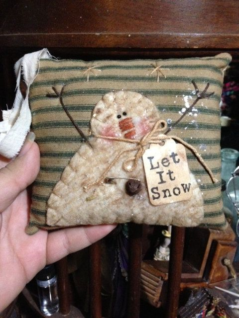 Primitive appliqued snowman pillow
