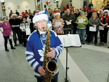 Seasonal sendoff in Barrie - Staff at Barrie City Hall celebrated Christmas by singing carols one last time with Noel Banavage.