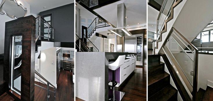 Escalier en acier peinturé, garde-corps en verre. main courante et poteaux en acier inoxydable.