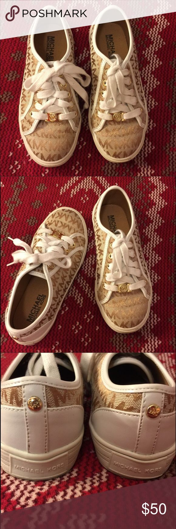Michael Kors Limited Edition Gold Kids Sneakers Michael Kors white and gold limited edition kids sneakers! Worn once for family portraits so in amazing condition, only wear at the bottom of the shoe from walking for an hour. Originally 87$ and sold out in stores! Michael Kors Shoes Sneakers