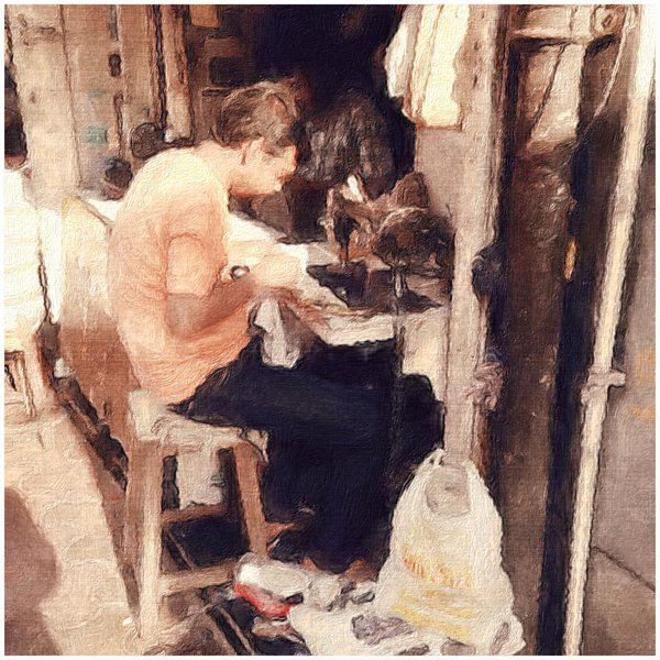 Sketch of a man sewing by the street in Colaba, Mumbai