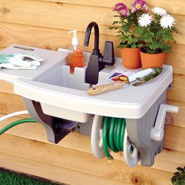 Outdoor sink.  No {extra} plumbing required. great for the kids to wash hands outside. connects to any outside spigot.  Seriously genius