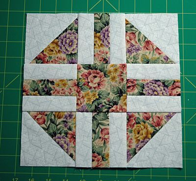Paths and Stiles Quilt Block Pattern. This would make a fun group project to use up extra fabrics - maybe with a gray or other colored background?