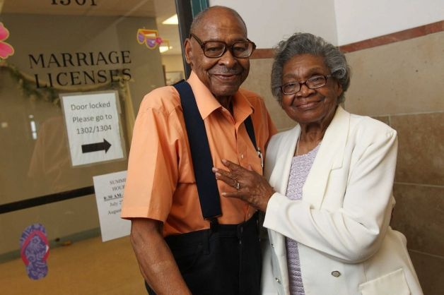 In a Monday, July 23, 2012 photo, Roland Davis of Colorado, left, and Lena Henderson of West Seneca, N.Y. pose for a photo at the Buffalo City Hall. DAvis and Henderson were divorced 50 years ago in Georgia.  At 85, they are remarrying.  They went to City Hall to get their marriage license,, for their August 4 wedding.    TV OUT; MAGS OUT; MANDATORY CREDIT; BATAVIA DAILY NEWS OUT; DUNKIRK OBSERVER OUT; JAMESTOWN POST-JOURNAL OUT; LOCKPORT UNION-SUN JOURNAL OUT; NIAGARA GAZETTE OUT; OLEAN…