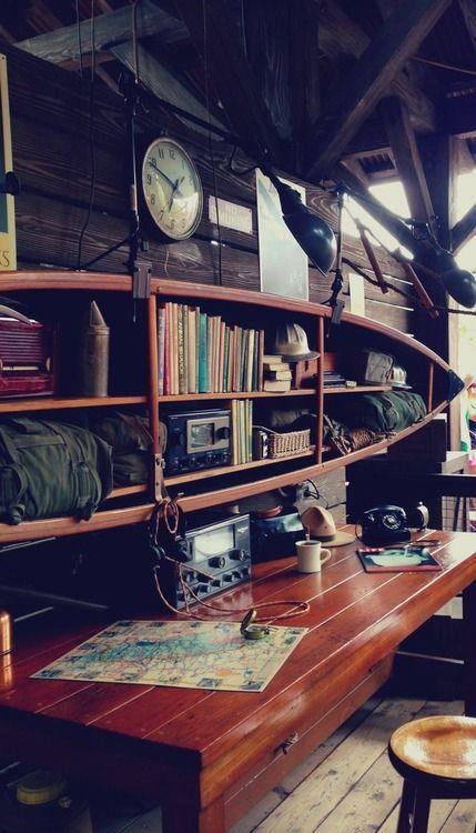 Canoe bookshelf---it could work in a ultra rustic cabin.