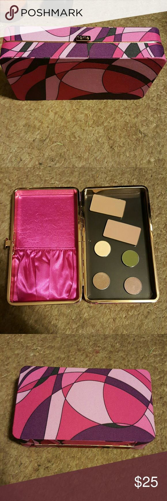 Tarte brush case/ magnetic palette Perfect for travelling. Came with the holiday brush set. Never used it except to take pictures. One side has a pouch to store brushes and the other side is magnetic so it serves kind of as a Z pallette. Eyeshadow pans and contour pans not included. Listing is for case only!! tarte Makeup Brushes & Tools