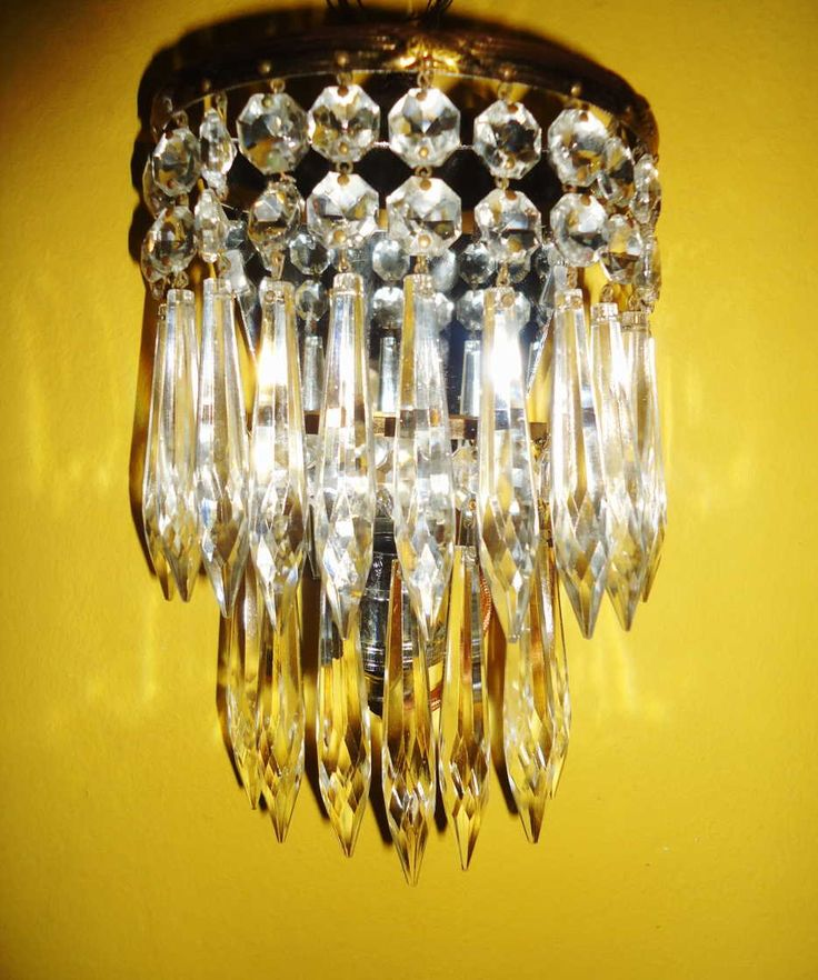 Antique pair of crystal wall sconces