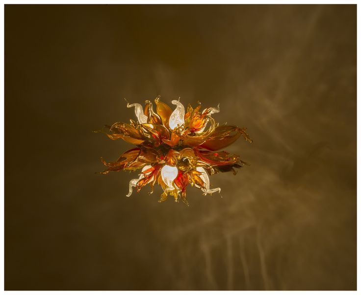 Modern chandelier made of hand blown glass. Serial production.