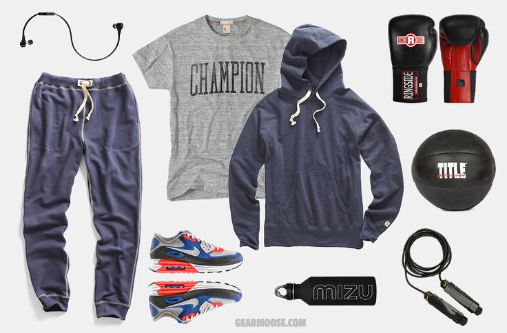 You can't box like a champion without training like a champion. Todd Snyder Warm-Up Sweatpants ($125). Champion Logo T-Shirt ($39). Todd Snyder Classic Hoodie ($145). Bluebuds X Earphones ($150). Nike Air Max Lunar 90 C 3.0 Running Shoes ($140). Ringside IMF Tech Sparring Gloves ($62). Nike Weighted Jump Rope ($17). Title Classic Leather Medicine Ball ($50). M8 Water Bottle + Sport Cap ($20).