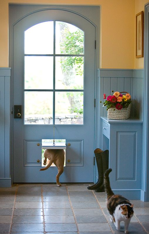 A clever pet door in the mudroom allows the homeowners' animals to come in and out on their own schedules. Finishes are all pet friendly. - Traditional Home ® / Photo: Ron Blunt