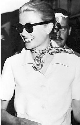 The power of a crisp white blouse, neck scarf and perfect sunnies