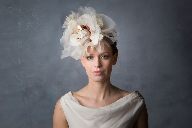 Large Flower Boho Bridal Headdress This oversized Flower headpiece is made from various organza's, velveteens, and other materials in creams and off-whites, to give a vintage look. Perfect for a Bohemian style wedding.  On a thin metal alice band.