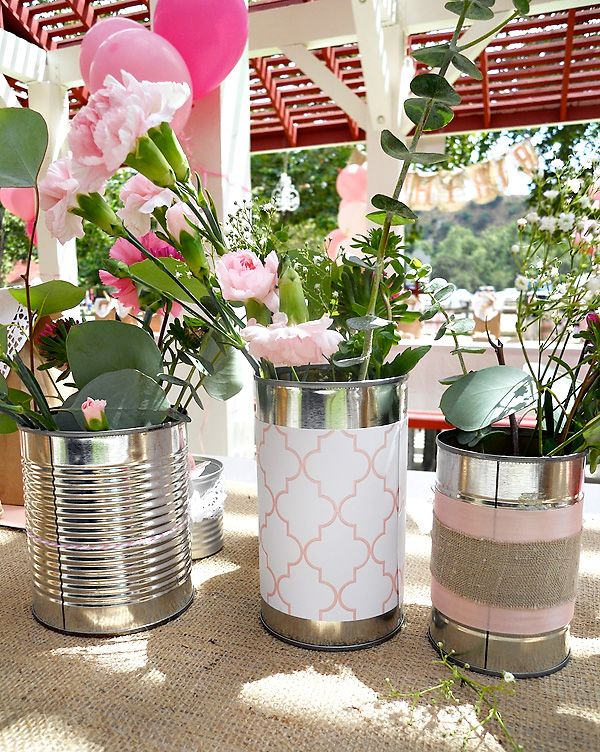 used cans with paper and ribbon as vases. I think mine were even cuter than the pic.  Def. using this idea again and again.