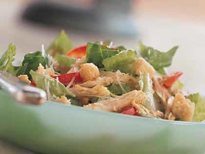 Chicken Caesar Salad | This chicken Caesar salad recipe is one of our top-rated! Using a precooked rotisserie chicken makes this salad extra easy and fast, although any leftover cooked chicken will work.