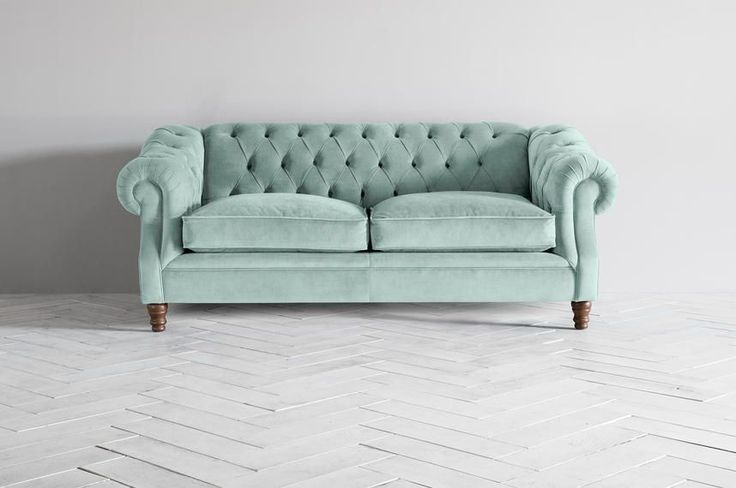 A grand, imposing Chesterfield pull-out sofa bed