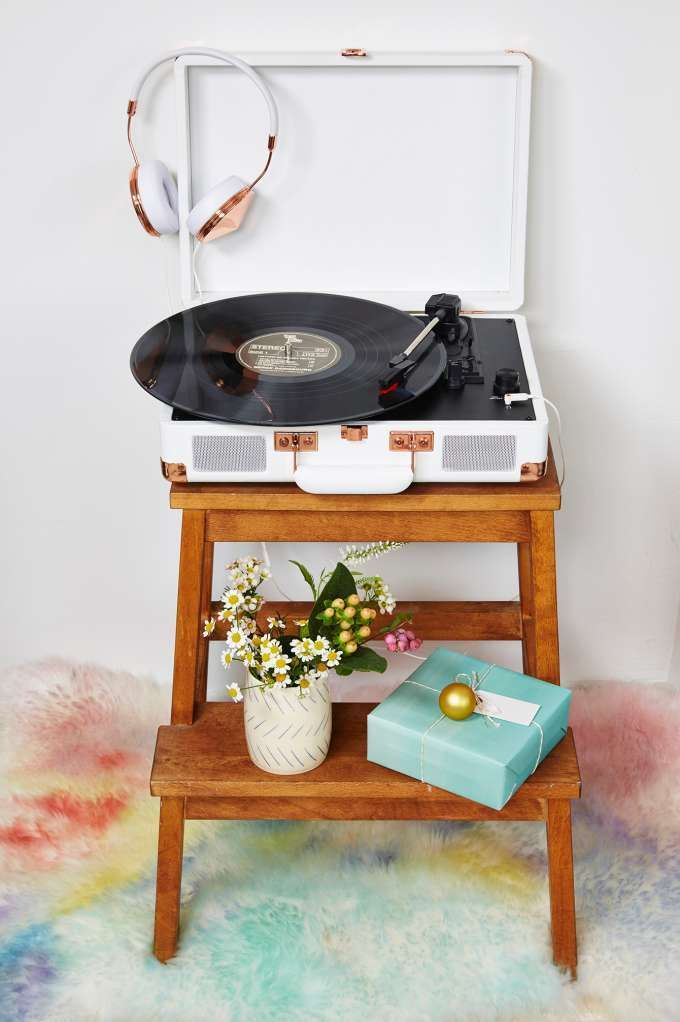 Crosley Rock Out Portable Turntable  Listen up, ladies. This white and rose gold turntable is about to be your new best (music) friend. It plays at three speeds and has stereo speakers with a full dynamic range. Also, you can use the headphone jack to plug-in your iPad or iPhone! So turn up your jams and get ready to rock out.
