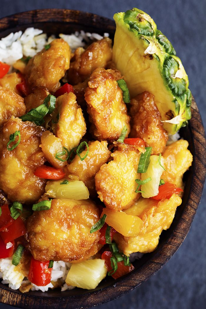"""Delicious chicken that gets breaded and baked in a sweet and tangy pineapple sauce. It bakes to perfection and is so much better than takeout! My love for this """"baked chicken"""" all sta…"""