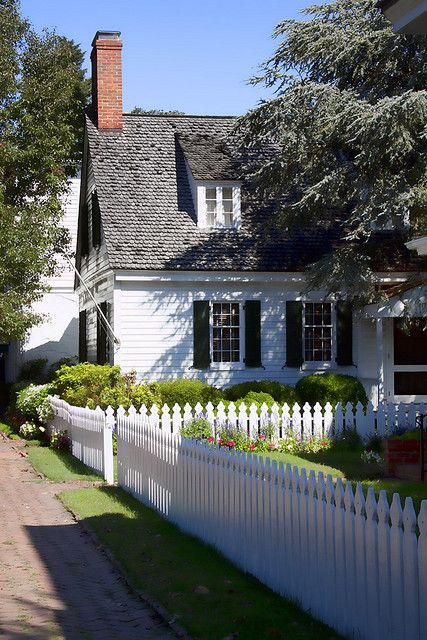This cottage with its white picket fence, is just the ticket for Sunday dinner. Done and done. Now come mow my lawn.