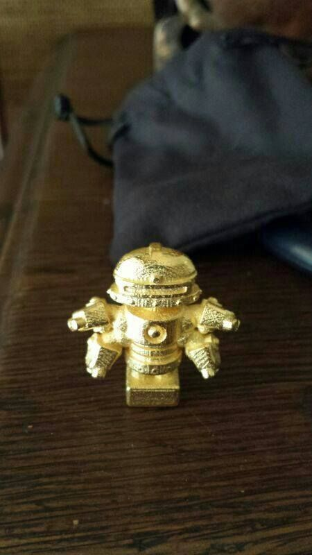 Nice robot 3d printed in gold by one of our users :) . 3D Printed by Shapeways