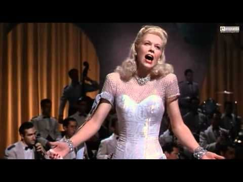 Doris Day  Song: It's Magic  Movie: Romance on the High Seas  Year: 1949    Lyrics:    You sigh, the song begins, you speak and I hear violins  It's magic  The stars desert the skies and rush to nestle in your eyes  It's magic    Without a golden wand or mystic charms  Fantastic things begin when I am in your arms    When we walk hand-in-hand, the world become...