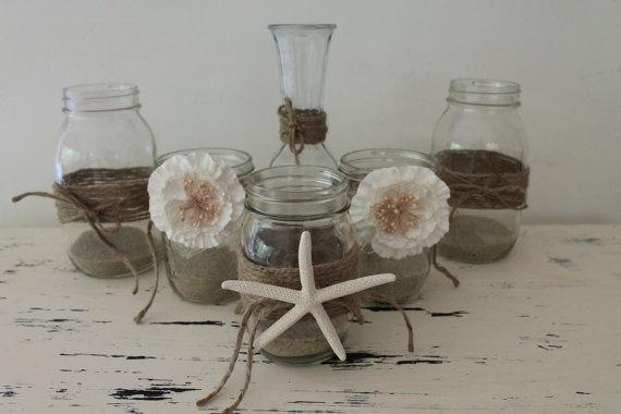 I like the mix of mason jars w/ burlap & seashells.  Rustic Beach Wedding Decor  Mixed Mason by RusticCottageDesigns, $70.00