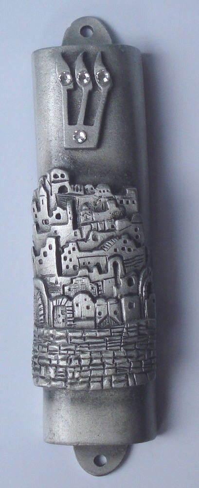 Mezuzah~ A parchment inscribed with religious texts and attached in a case to the doorpost of a Jewish house as a sign of faith.