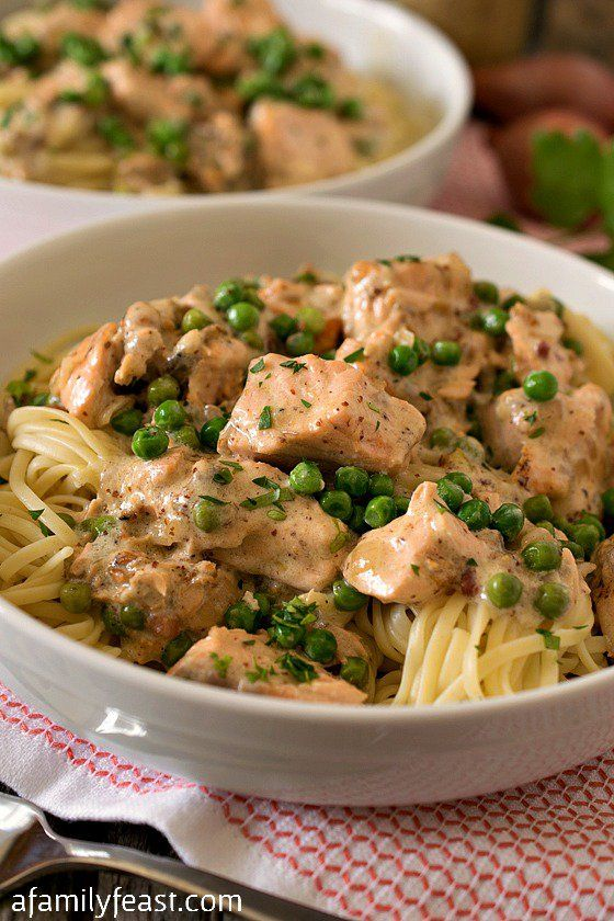 Creamed Salmon and Peas Over Linguini | www.afamilyfeast.com | Tender chunks of salmon sautéed in a wonderful cream and mustard sauce that is flavored with pancetta and shallots, then served over linguini. (It's incredible!)