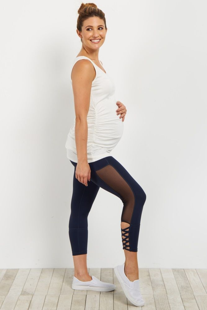 All of your favorite details are now in this amazing active maternity legging. A mesh accent gives a chic look while the crisscross cutout gives you edge. Throw these leggings on for yoga or wear them for a cute athleisure look.