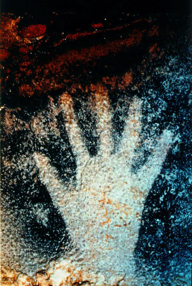A new study has revealed that most prehistoric art was probably done by women, because the majority (75%) of handprints found in caves (like this one at Pech Merle, France) have proven to be made by females by digitally measuring the difference in length of the fingers. The ring & index fingers of women are about the same length, whereas the ring fingers of men tend to be longer. Photo by Jean Vertut.