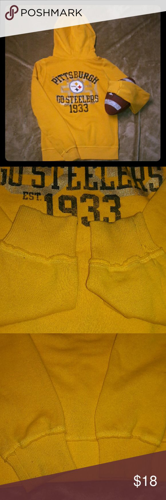 VS PINK Steelers Hoodie This classic black & yellow VS PINK Steelers hoodie is a size small. Their are some fuzzies along the bottom and shoulders, throughout the hoodie itself. I took pictures of the front and back sides of the bottom sleeves to see discoloration from wear. Very comfortable. Price reflects flaws. This has been in my closet for years. PINK Victoria's Secret Tops Sweatshirts & Hoodies